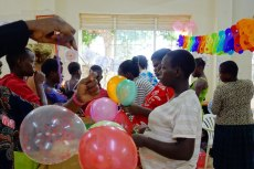 Blowing ballons was fun. The little girls in them came out